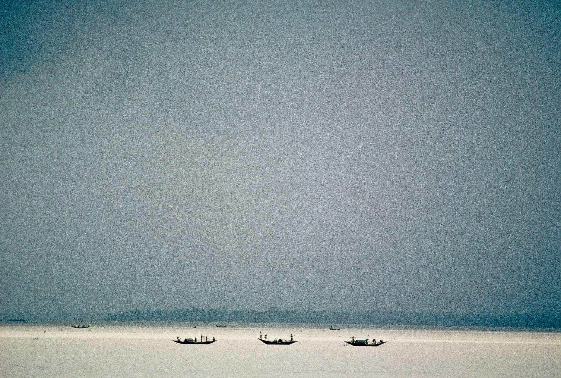 Fishing on the Pankali river 1990, Bangladesh