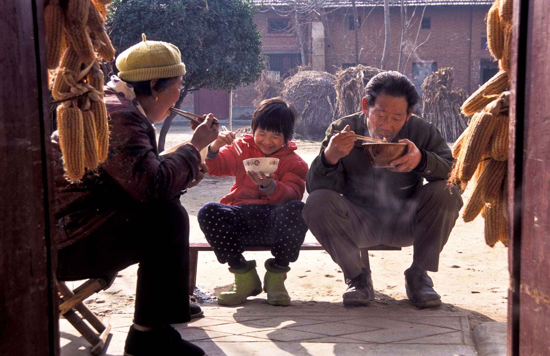 Family having lunch in Chinese village