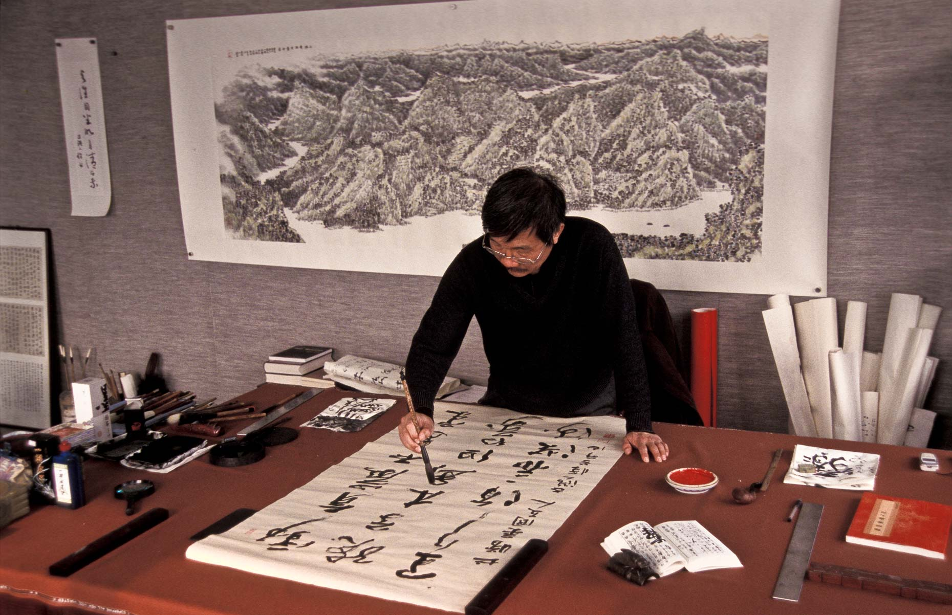 Calligrapher at work in studio