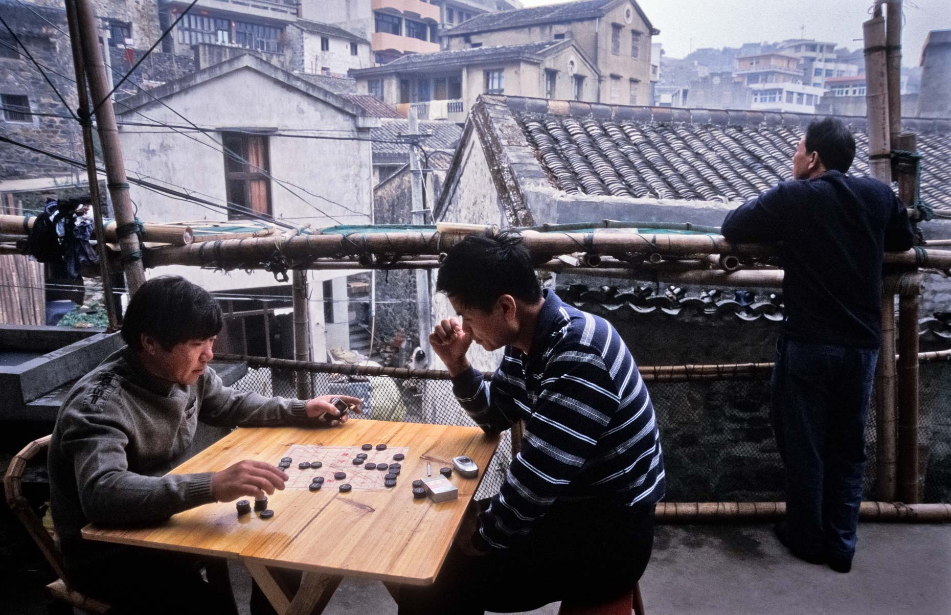 Two men play Chinese chess