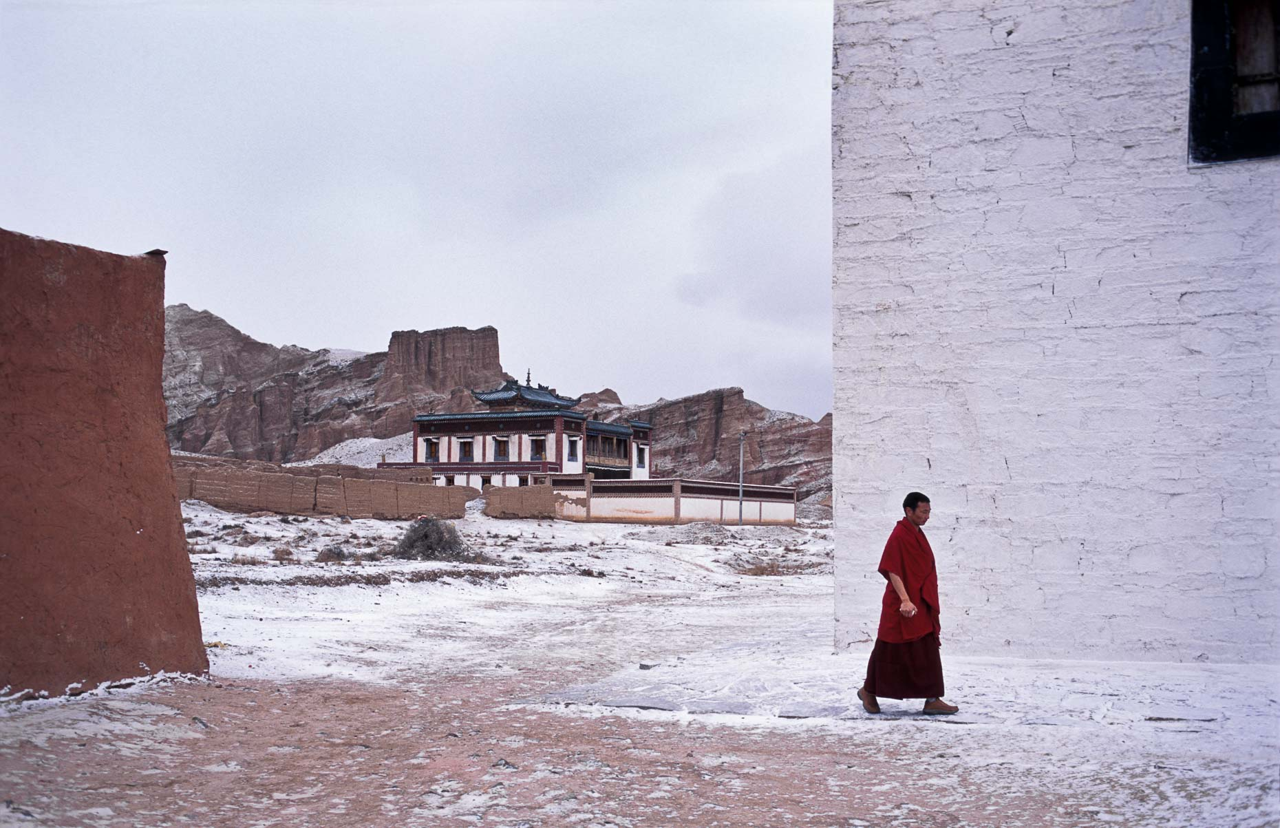 Tibetan buddihist monk walks through monastery